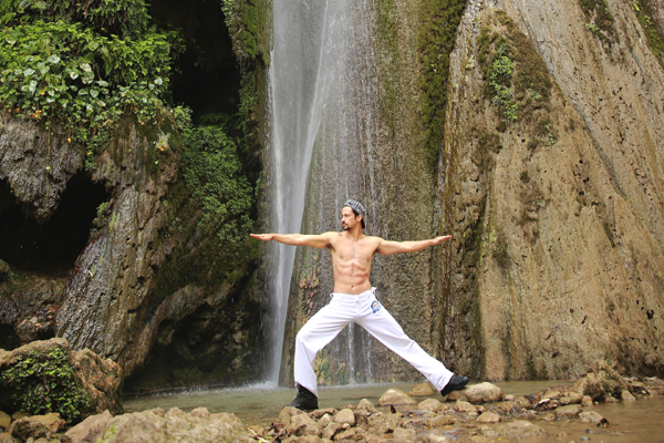 Yoga pose near waterfall 2