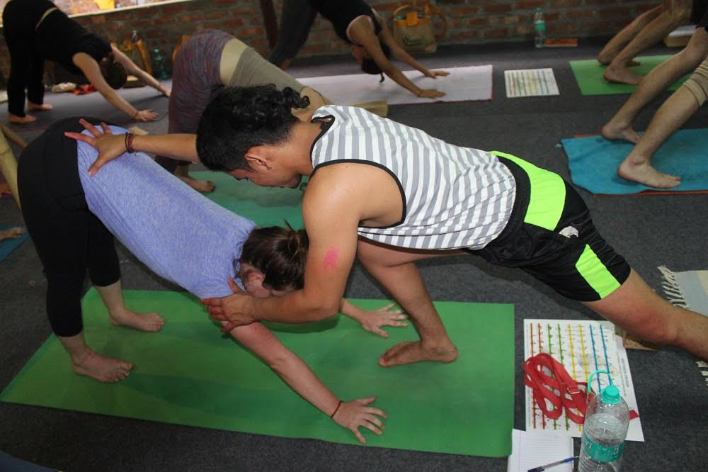 monika practicing yoga in rishikul yogshala