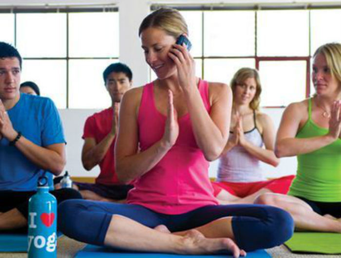 mobile phone in yoga class