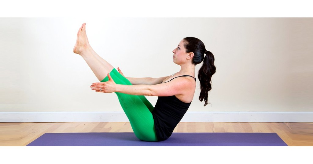 Navasana with Dumbbells